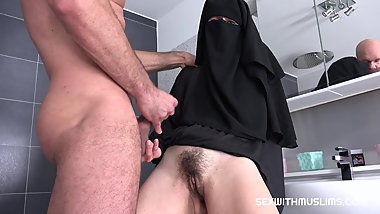 Randy Worker Helps Valentina Ross in Niqab