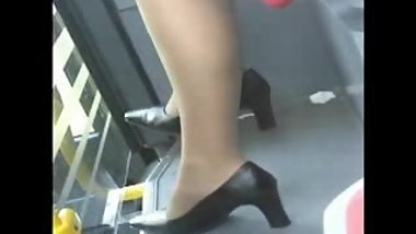 Candid asian double crossed legs on train