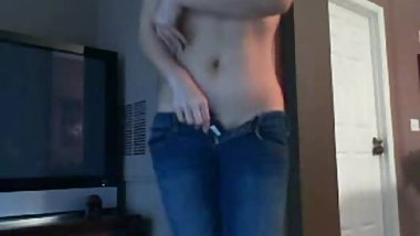 Horny asian in jeans pleasing herself