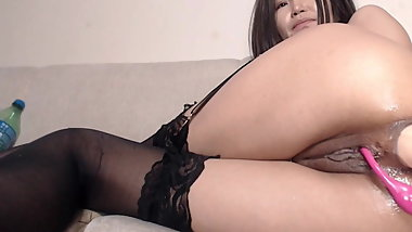 Asian fucks her tight pussy and wet asshole with huge toy