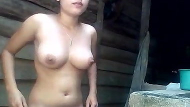 Big boobs country girl shows everything while bathing