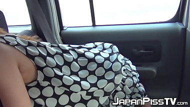 Kinky Japanese chick loves peeing and doing it in the car
