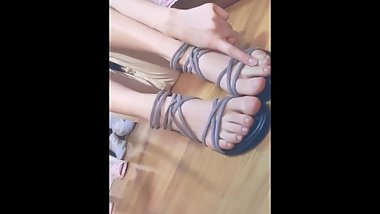 Chinese student girl show her cute feet