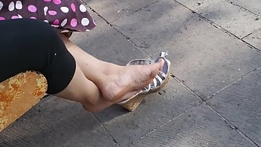 mature asian resting feet