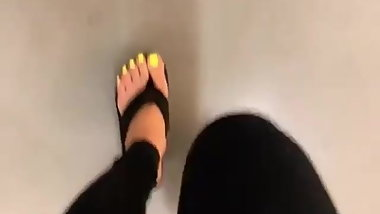 Mature feet walking in platform flip flops
